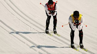 Brian McKeever, left, is led by his sighted guide, brother Robin McKeever. (Nick Laham/Getty Images)